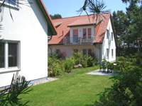 Baltic Sea Holiday Apartments Koelpinsee on the island Usedom. Yard and barbecue.